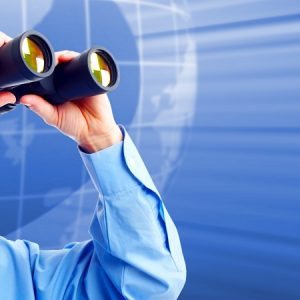 Businessman with binoculars. Techno futuristic background.